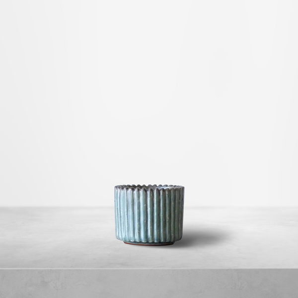 Arne Bang for Royal Copenhagen, small light blue ribbed ceramic cup, 1940s
