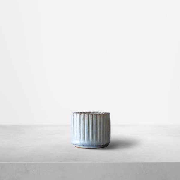 Arne Bang for Royal Copenhagen, small teal-colored ribbed ceramic cup, 1940s